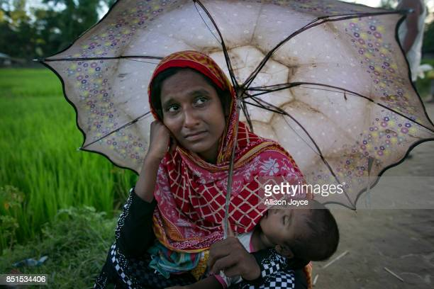 COX'S BAZAR BANGLADESH SEPTEMBER 21 23 year old Ruma cries with her baby by the side of the road near Unchiprang camp on September 21 2017 in Cox's...