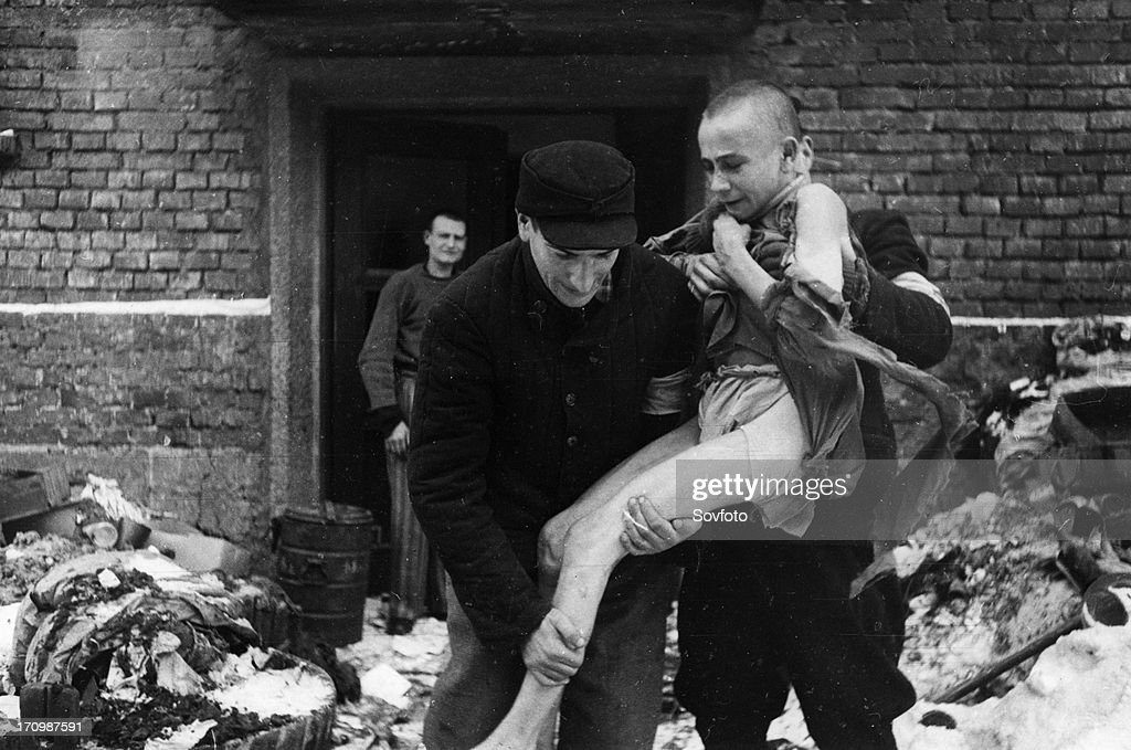 A 15 year old russian boy, ivan dudnik, who was brought to auschwitz from his home in the orel region by the nazis, being rescued, he has gone insane from witnessing the horrors of the camp, february 1945.