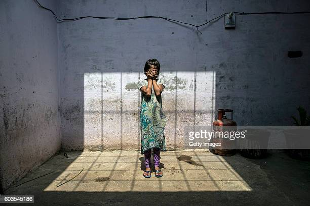8 year old Sadaf stands for a photo in her home on September 8 2016 in Uttar Pradesh India 3 months ago she was raped by a doctor in her village She...