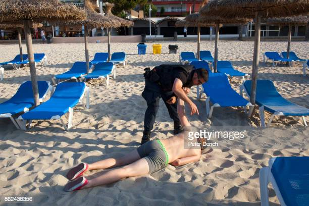 0804 32 year old security officer George tries to wake a British man found slumped on the beach in Magaluf Majorca George works a nine hour shift...