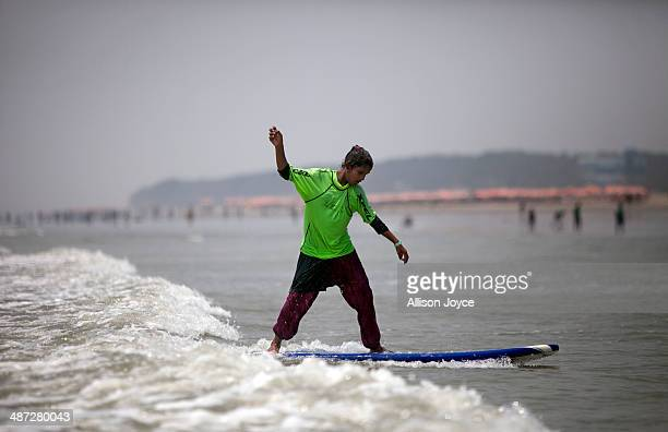 COX'S BAZAR BANGLADESH APRIL 24 12 year old Shuma competes during the annual Cox's Bazar surf competition April 24 2014 in Cox's Bazar Bangladesh A...