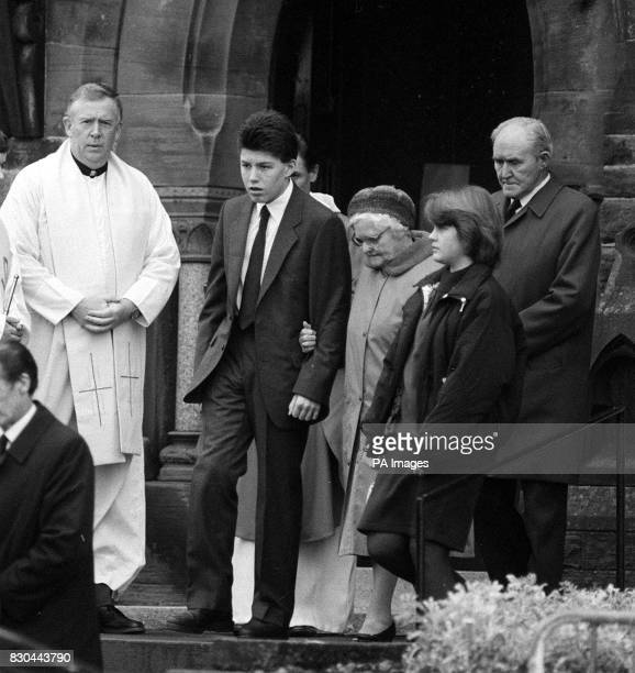 14 year old Steven Flannigan is comforted by relatives at the funeral of his sister Joanne who died with their parents in the Pan Am 747 disaster...