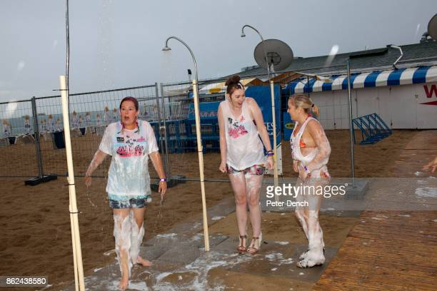 1533 19 year old students Kelly and Paige from Stoke shower foam from themselves after attending a party organised by The Party Crew at Guaba Beach...