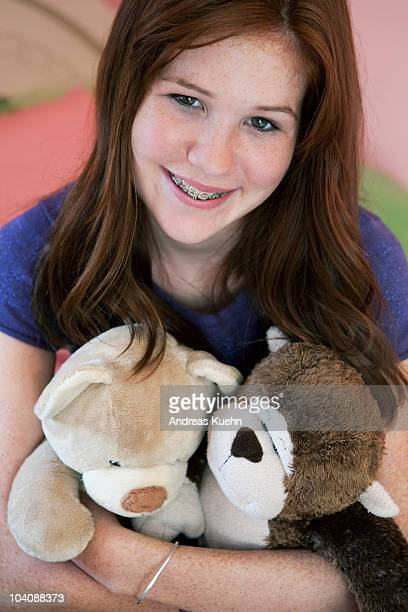 13 year old teenage girl with braces smiling.