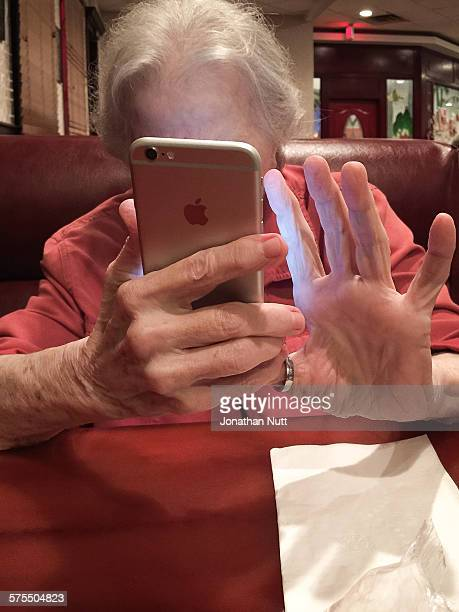 80 year old using her smartphone to check in with friends and family and share photos on various social networks