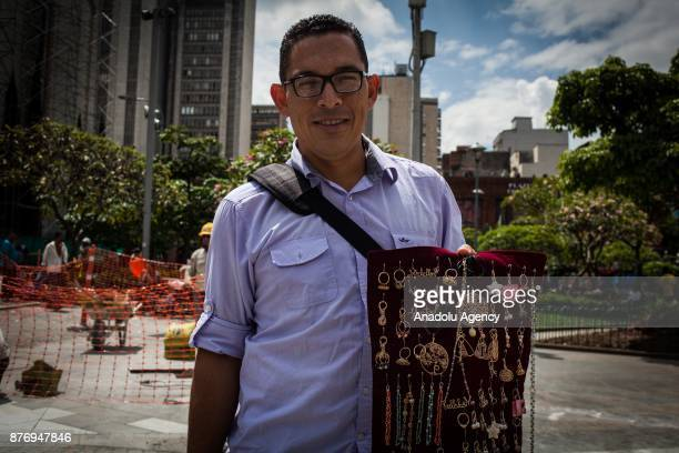36 year old Venezuelan lawyer Daniel Marcano sells his hand made souvenirs to provide his living in Medellin Colombia on November 20 2017 After a...