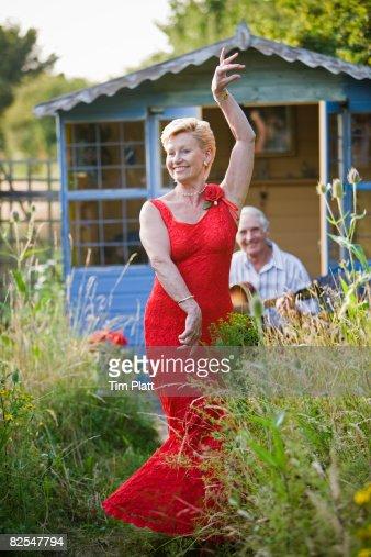 63 year old woman dancing in garden : Stock Photo