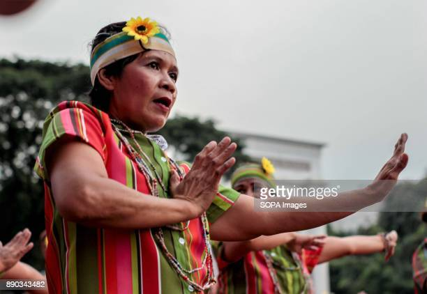 Year Old Woman of the Senior Citizens Association powerfully dances to the beat of traditional folk step in their regionThe Biggest Annual Philippine...