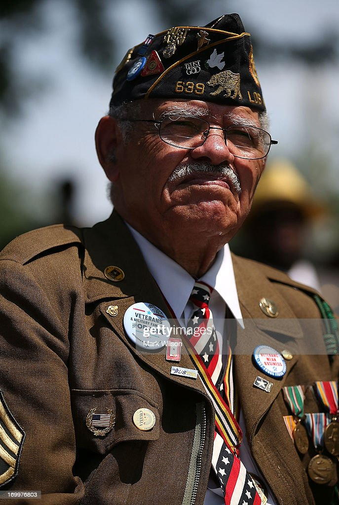92 year old WWII veteran Staff Sgt. Stephen R. Sherman Ret. attends wreath laying ceremony at the gravesite of Buffalo Soldier Col. Charles Young, at Arlington Cemetery, June 5, 2013 in Arlington, Virginia. The event was hosted by the National Coalition of Black Veterans and the Omega Psi Phi Fraternity to celebrate the 90th anniversary of 'Buffalo Soldier' and military leader Col. Charles Young's internment in Arlington Cemetery.