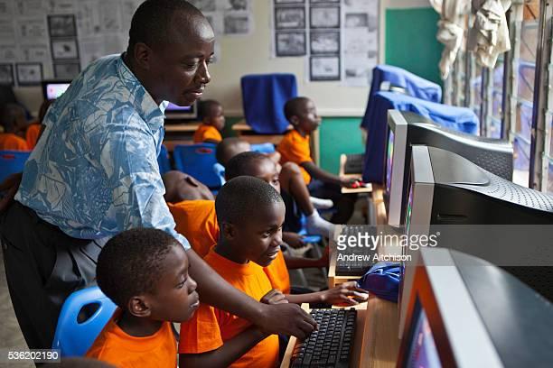 56 year olds having a computer lesson at the kindergarten school of the Wema Centre Mombassa Kenya Wema provide a rehabilitation program for street...