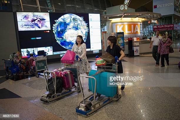 Year2014aviationaccidentsafetyFOCUS BY Dan Martin This photo taken on December 11 shows tourists pushing their luggage for checkin at Kuala Lumpur...