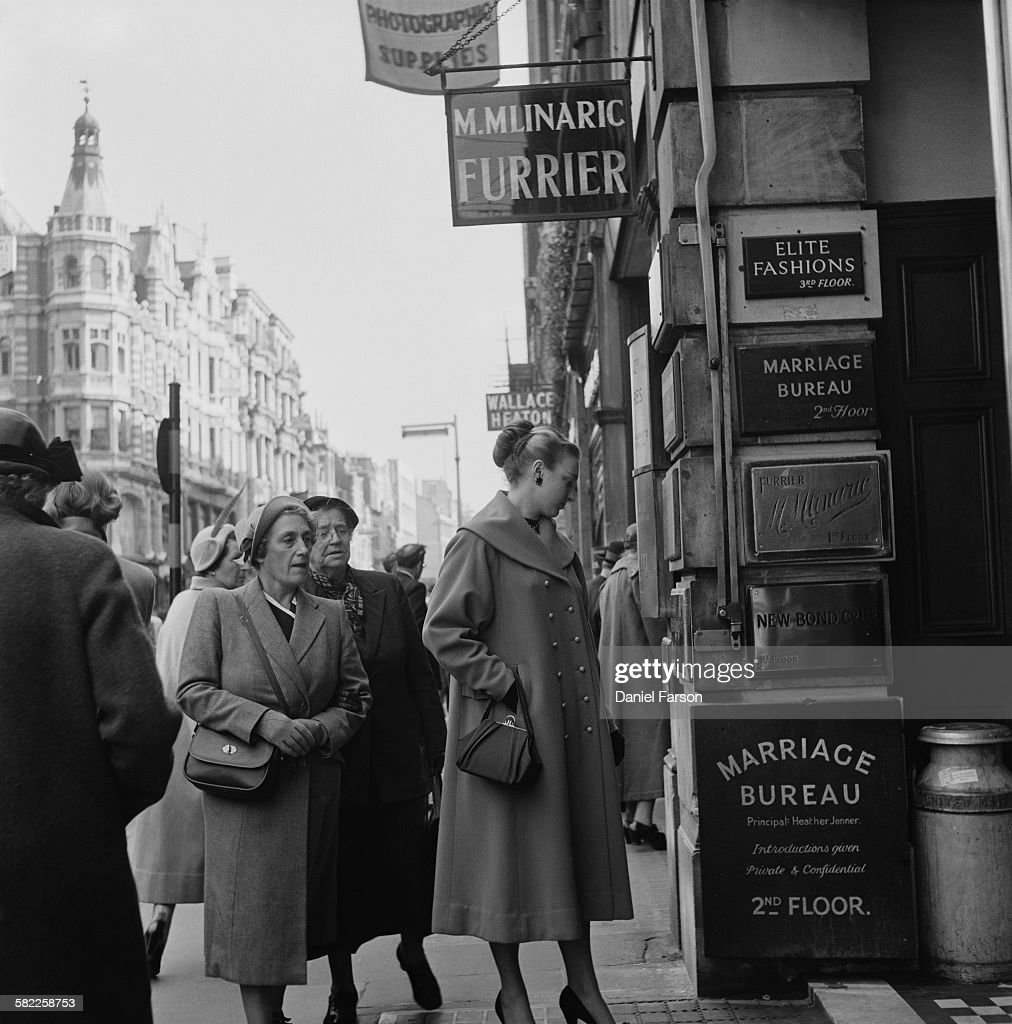 A 21 yearold actress named Pam outside the offices of the Marriage Bureau dating agency in Bond Street London December 1952 The agency was founded by...