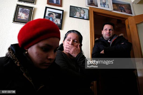 52 yearold Agustina Molina Montes from Ecuador in company of her daughter Tania Cedillo Montes 25 and her neighbor Mauricio Lobato 45 gestures as she...