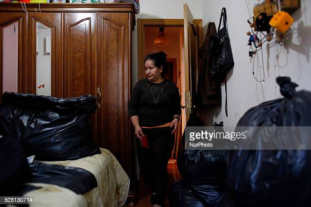 52 yearold Agustina Molina Montes from Ecuador looks at her room where things are packed in case she has to leave her house as she waits to be...