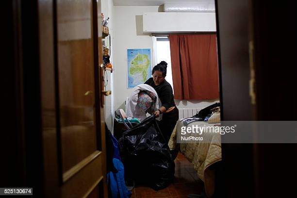 52 yearold Agustina Molina Montes from Ecuador packs her belongings as she waits to be evicted from her home in Madrid 52 yearold Agustina Molina...