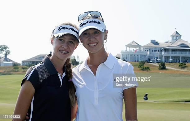 14 yearold amateur Nelly Korda poses with her sister Jessica during a practice round prior to the start of the 2013 US Women's Open at Sebonack Golf...