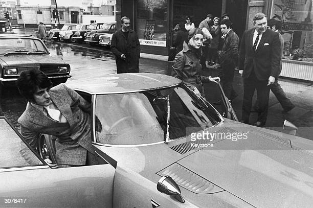 18 yearold British fashion model Twiggy getting into her new Toyota 200 GT sports car a gift from the Toyota Company of Japan 9th February 1968 As...
