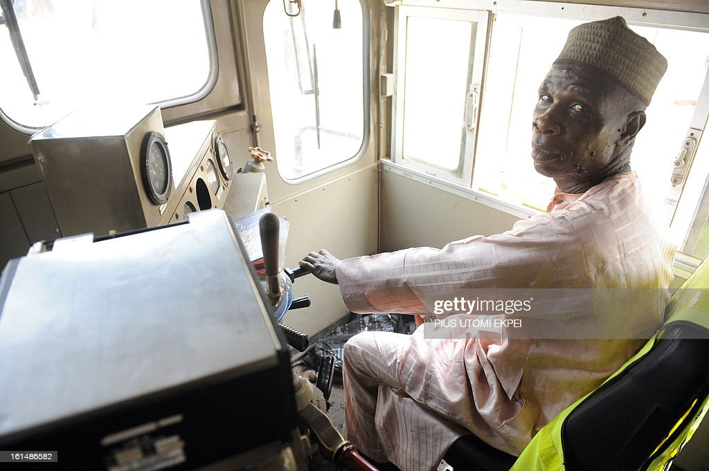 58 year-old captain Kabiru Abubakar holds steering of Lagos-Kano route train on February 8, 2013. The rejuvenated Nigerian Railway Corporation has resumed passenger and haulage services on the Lagos-Kano route following the refurbishing of engines and coaches over 20 years the corporation had gone bankrupt. Earlier last year, the corporation had acquired 20 pressurised tank wagons in preparation for the haulage of petroleum products from Lagos to northern parts of the country. The 20 wagons have the capacity to lift 900,000 litres of petroleum products, the equivalent of 27 road tankers.