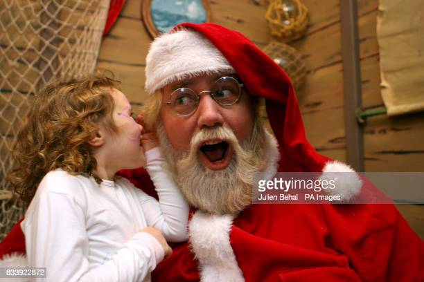 5 yearold Erika O'Reilly tells Santa Claus what she would like for Christmas as he visits Stephens Green Shopping Centre in Dublin