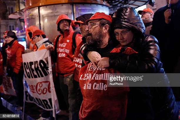 56 yearold Francisco I����igo who has been working 32 years in maintenance at cocacola's factory is embraced by her 55 year old wife Aurora Jurado...