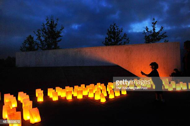 4 yearold Ian Kimel takes an iPhone photo of the luminaria at the Wall of Names are of the Flight 93 National Memorial He was with his mother Amy...