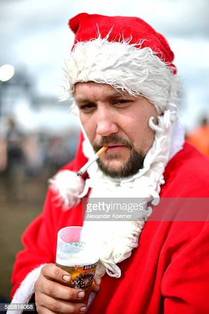 27 yearold Mark from Randers Denmark stands dressed as Santa Claus during the Wacken Open Air festival on August 4 2016 in Wacken Germany Wacken is a...