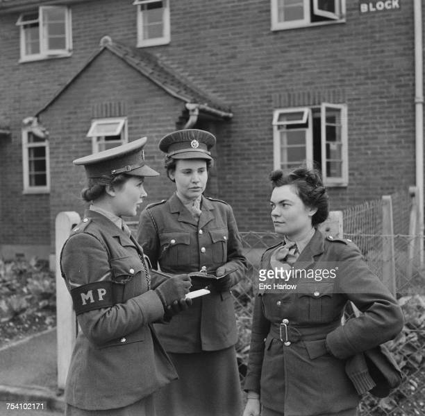 19 yearold Military Policewoman Gladys Overthrow of the Auxiliary Territorial Service on patrol at a UK barracks 24th February 1943 Overthrow from...