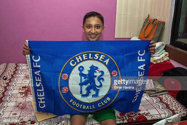 14 yearold Sandesh Basnet holds a Chelsea FC flag sent by the club and his favourite player Eden Hazard on August 26 2015 in Kathmandu Nepal On April...