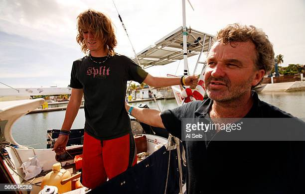 17–year–old Zac Sunderland says goodbye to his father Laurence Sunderland on June 25 2009 before setting sail aboard his 36–foot sailboat 'Intrepid'...