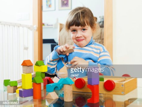 3 years child playing with toys in home : Stock Photo