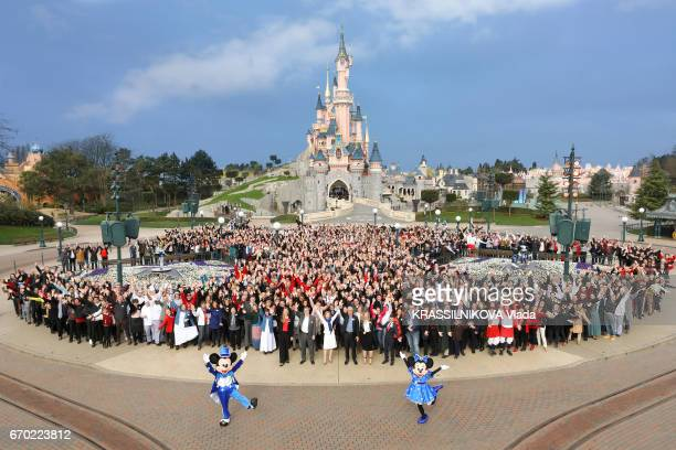 25 years of the park Disneyland Paris with the CEO of Euro Disney Catherine Powell and 15000 employees of the park pose for Paris Match on march 15...