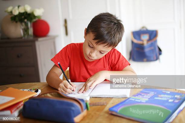 A 7 years old boy doing his homework