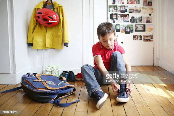 A 7 years old boy is ready to go to school