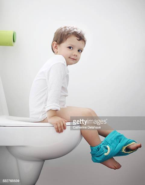 A 2 years old boy on the toilet