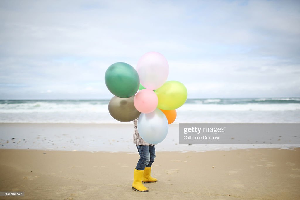 A 3 years old boy playing on the beach : Stock Photo
