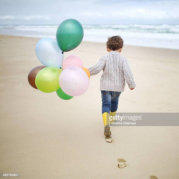 A 3 years old boy playing on the beach
