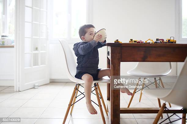 A 3 years old boy taking his breakfast