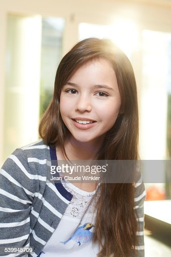 11 Years Old Girl At Home Back Light Smiling Stock Photo