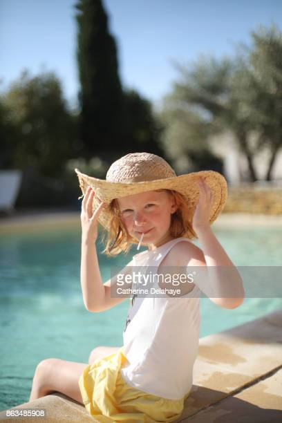 A 6 years old girl by the swimming pool