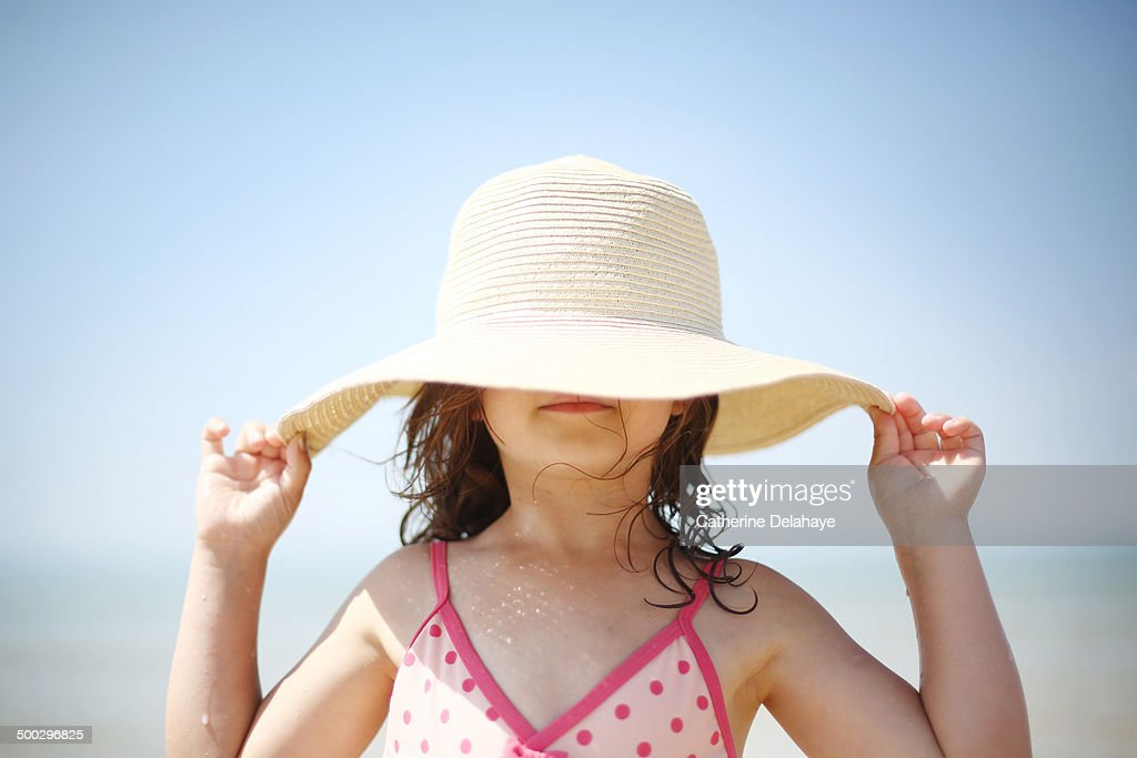 A 5 years old girl on the beach