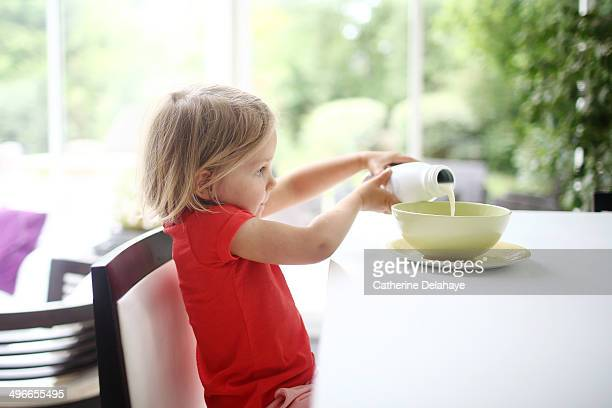 A 3 years old girl taking her breakfast