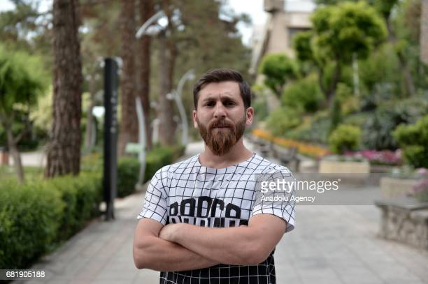 25 years old Iranian Lionel Messi lookalike university student Reza Parastesh poses for a photo in Tehran Iran on May 11 2017 Reza grew a beard...
