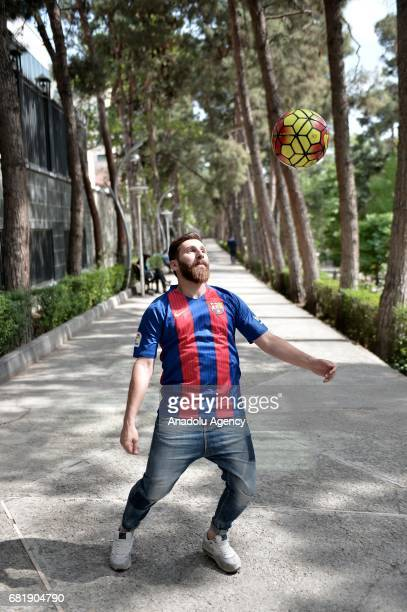 25 years old Iranian Lionel Messi lookalike university student Reza Parastesh juggles in Tehran Iran on May 11 2017 Reza grew a beard similar to...