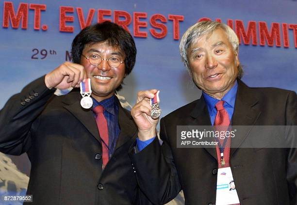 70 years old Japnaese skier Yuichrio Miura who became the oldest man to summit the Mt Everest 22 May and his son Gota Miura show their memorial...