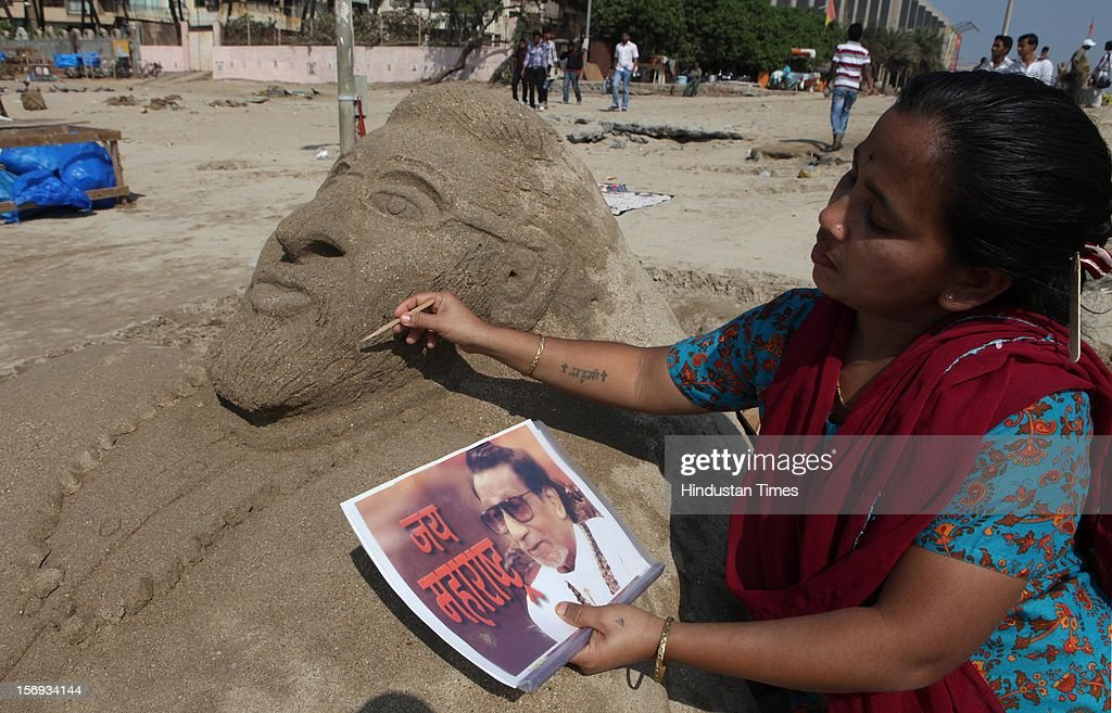 31 years old Laxmi Gaud Kamle makes a sand sculpture on the 85th birthday of Balasaheb Thackeray at Juhu chowpatty on January 23, 2012 in Mumbai, India. (Photo by Puneet Chandok/Hindustan Times Via Getty Images).