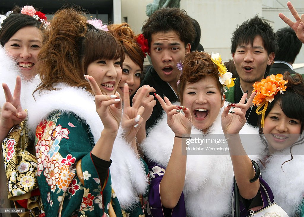 20 years old local residents dressed in traditional kimonos pose for a picture during the Coming of Age Day at Cultural Hall on January 14, 2013 in Himeji, Japan. The event involves 20-year-old Japanese people celebrating their eligibility to drink alcohol, smoke and vote.