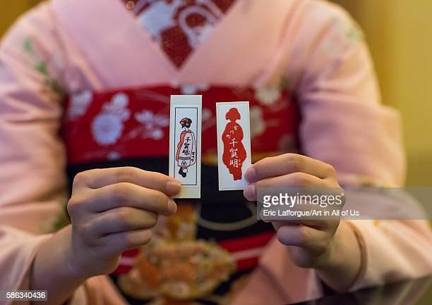 16 years old maiko called chikasaya showing her business cards kansai region kyoto Japan on May 27 2016 in Kyoto Japan