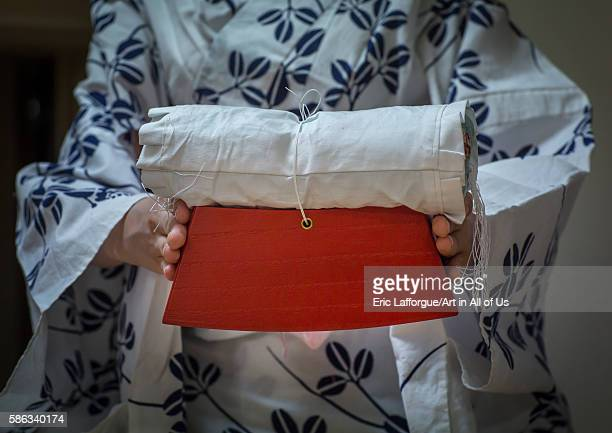16 years old maiko called chikasaya with the pillow shes uses to protect her hairstyle kansai region kyoto Japan on May 27 2016 in Kyoto Japan