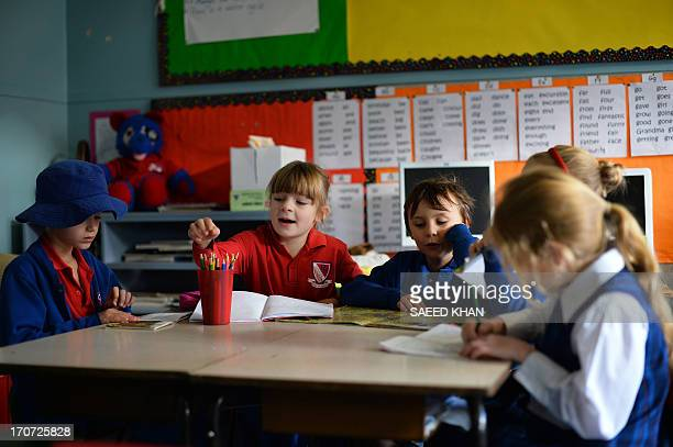 WORLD 6 years old student Frances McMillan studies with classmates inside a classroom at school in the Coogee suburb of Sydney on June 17 2013 AFP...