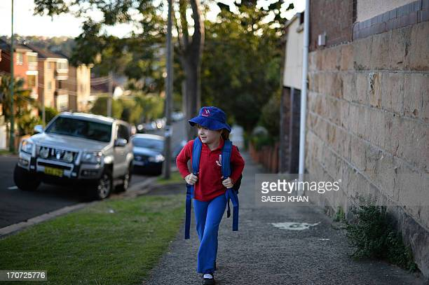 WORLD 6 years old student Frances McMillan walks to school in the Coogee suburb of Sydney on June 17 2013 AFP PHOTO / Saeed KHAN